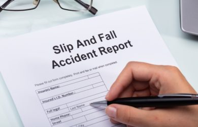 Woman Filling Out Slip and Fall Accident Report